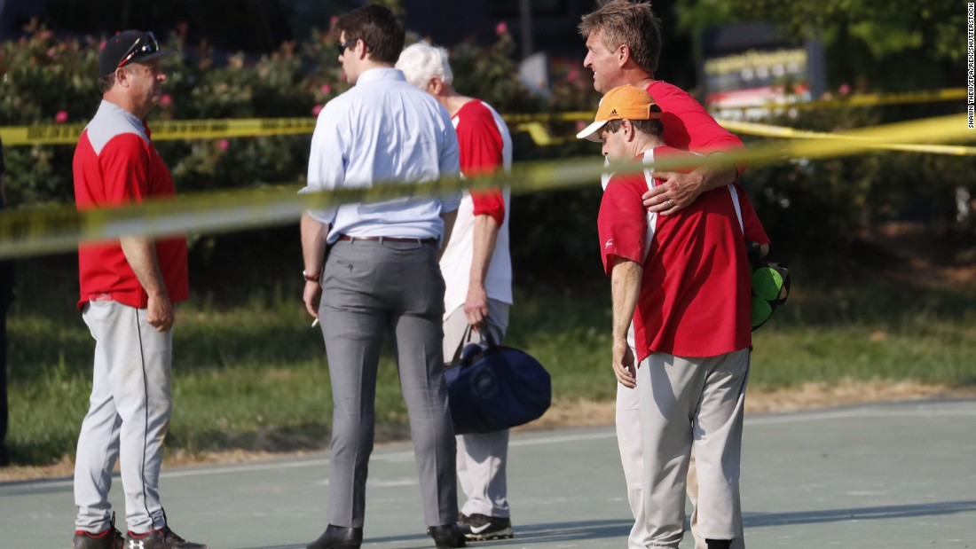 US Sen. Jeff Flake hugs another member of the Republican congressional baseball team after the shooting.