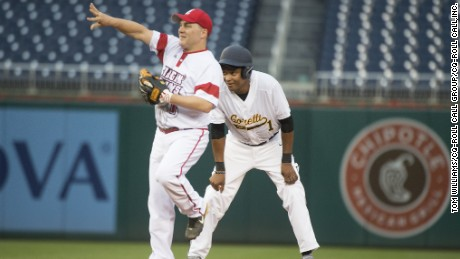 Reps. Cedric Richmond, D-La., right, and Steve Scalise, R-La., play during the Republicans' 8-7 victory in the 55th Congressional Baseball Game at Nationals Park, June 23, 2016.