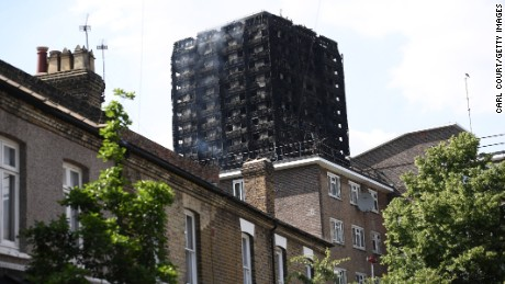 Smoke continues to rise from the 24 storey residential Grenfell Tower block in Latimer Road, West London on June 14, 2017 in London, England.  The Mayor of London, Sadiq Khan, has declared the fire a major incident as more than 200 firefighters are still tackling the blaze, while at least 50 people are receiving hospital treatment.