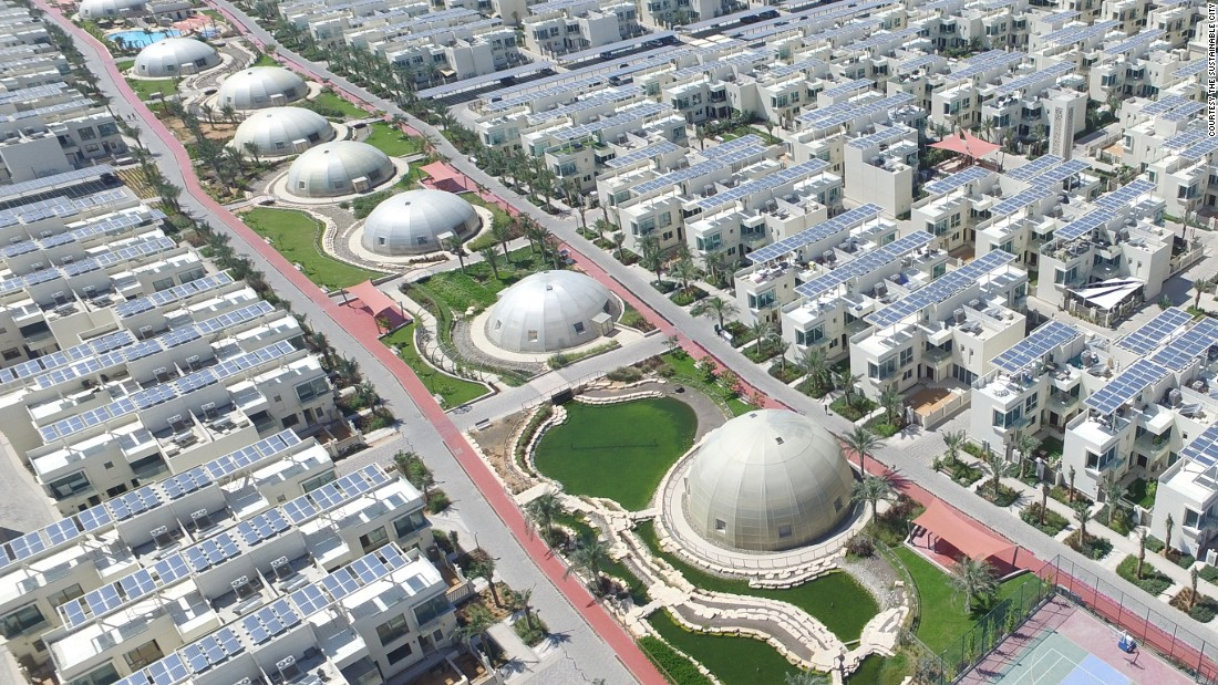 Cities and their inhabitants produce huge amounts of green house gases, contributing to global warming and environmental damage. In response, a number of communities are focused on reducing their carbon-emissions, with some attempting to go entirely carbon-free. <br /><br />The Sustainable City in Dubai, a 500-home complex outside Dubai City, proposes one solution. Scroll through the gallery to discover how other communities are living sustainably.