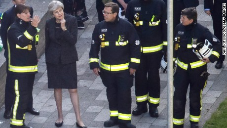 May consults with London Fire Commissioner Dany Cotton, left, at the scene of the fire Thursday.