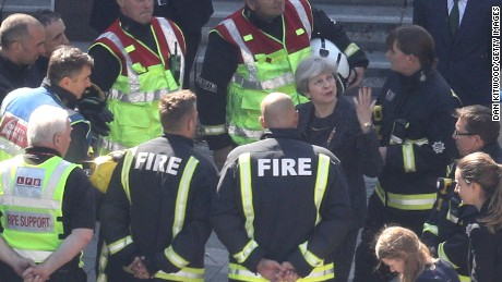 British  Prime Minister Theresa May speaks to members of the fire service as she visits Grenfell Tower.