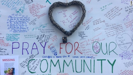 Messages of hope written on a poster near Grenfell Tower.