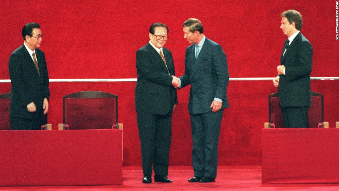 Chinese President Jiang Zemin shakes hands with Britain's Prince Charles following Hong Kong's transfer of sovereignty from British to Chinese rule on July 1, 1997.
