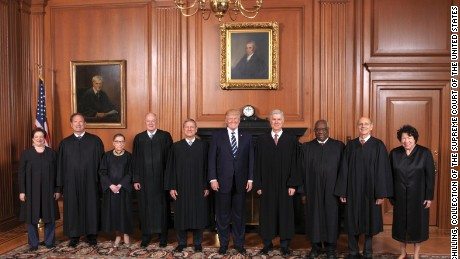 The Supreme Court held a special sitting on June 15, 2017, for the formal investiture ceremony of Associate Justice Neil M. Gorsuch.  President Donald J. Trump and First Lady Melania Trump attended as guests of the Court.  Members of the Supreme Court with the President in the Justices' Conference Room at a courtesy visit prior to the investiture ceremony. From left to right: Associate Justices Elena Kagan, Samuel A. Alito, Jr., Ruth Bader Ginsburg, and Anthony M. Kennedy, Chief Justice John G. Roberts, Jr., President Donald J. Trump, and Associate Justices Neil M. Gorsuch, Clarence Thomas, Stephen G. Breyer, and Sonia Sotomayor.