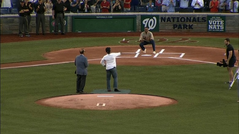 Wounded officer throws first pitch