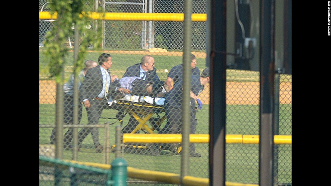 "A wounded person is stretchered away from a baseball field in Alexandria, Virginia, on Wednesday, June 14. A gunman <a href=""http://www.cnn.com/2017/06/14/politics/gallery/virginia-gop-shooting/index.html"" target=""_blank"">opened fire on Republican congressmen</a> as they practiced baseball at the field. House Majority Whip Steve Scalise, a congressional staffer, a lobbyist and two members of the congressional police force were among those injured, officials said. The alleged gunman was killed."