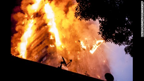 Falling burning debris at the scene of a huge fire at Grenfell tower block in White City, London Grenfell Tower fire, London, UK - 14 Jun 2017 The blaze engulfed the 27-storey building with 200 firefighters attending the scene. There were reports of people trapped in the building. (Rex Features via AP Images)