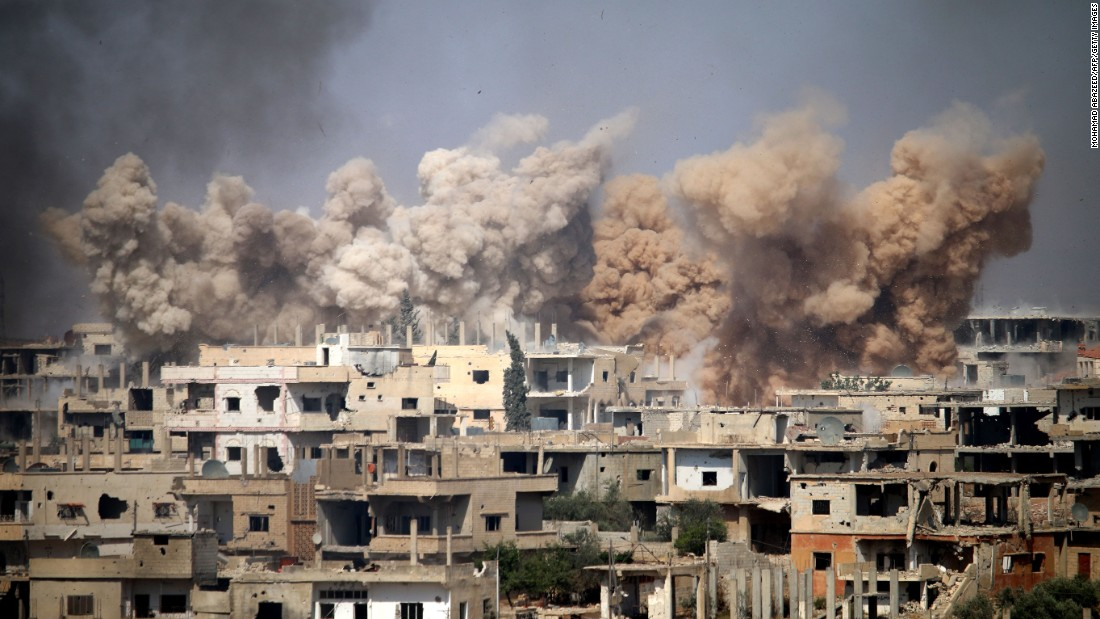 Smoke rises from buildings after a reported airstrike on a rebel-held area of Daraa, Syria, on Wednesday, June 14.