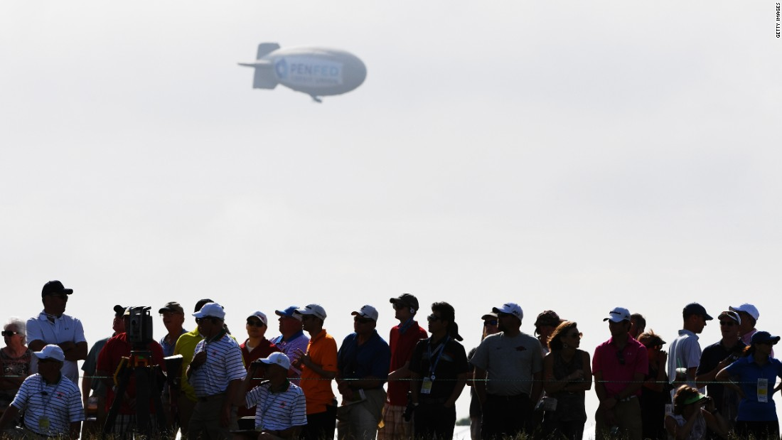 "Early on day one of the 117th US Open spectators and players saw a blimp fall out of the sky near the Erin Hills course in Wisconsin. The pilot was taken to hospital with ""serious burns,"" according to the Washington County Sheriff's Office."