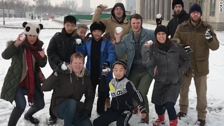 Otto Warmbier, fourth from the right in a blue jacket, throws a snowball in this photo from his trip to North Korea.