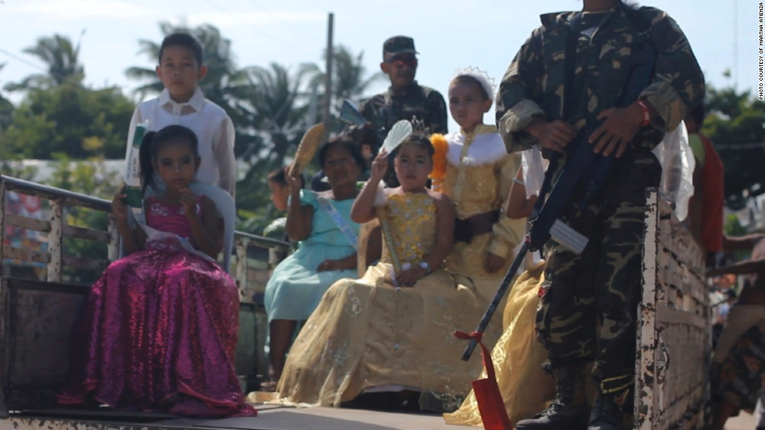 Young girls in pageant gowns participate in the Ati-Atihan Festival in Bantayan Island. The parade is held every year at the end of January.