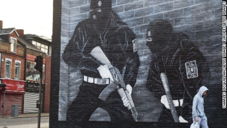 BELFAST, NORTHERN IRELAND - SEPTEMBER 21:  A man walks past a paramilitary mural on the Newtownards road on September 21, 2015 in Belfast, Northern Ireland. The Northern Irish political parties resumed round table talks today after the government commissioned an independent assessment of paramilitary activity. Arrests have been made after police found Semtex and other weapons in West Belfast last Thursday.  (Photo by Charles McQuillan/Getty Images)