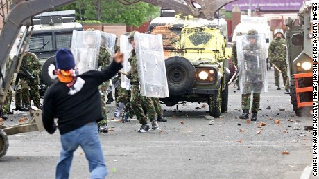 Republican protesters throw stones at British soldiers in 2002.