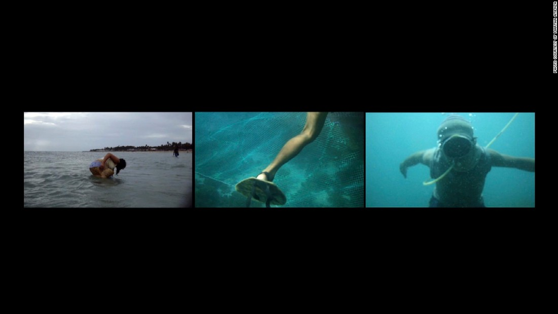 """My Navel is Buried in the Sea"" (2011) is a three-paneled video which began with Atienza filming compressor divers. ""Compressor diving is a dangerous way to make a living,"" she says. ""Makeshift equipment is used to dive to extreme depths. It is a result of extreme damage to the sea by man and nature. Men must go deep to make a catch."""