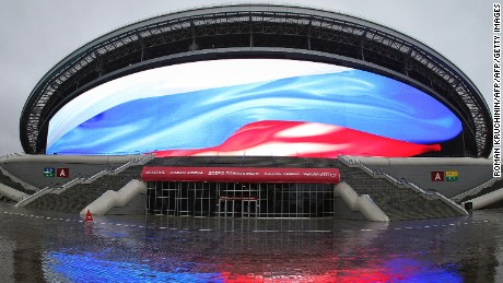 The Russian national colours are seen on a giant screen of the Kazan Arena football stadium during a visit of the FIFA inspection committee in Kazan on October 17, 2014. The joint delegation made up of FIFA and Russia 2018 World Cup organizing committee representatives are holding their first official inspection visit to the World Cup stadiums through until October 23. AFP PHOTO / ROMAN KRUCHININ        (Photo credit should read ROMAN KRUCHININ/AFP/Getty Images)