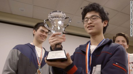 Tuan Bui holds a trophy at a memory competition.