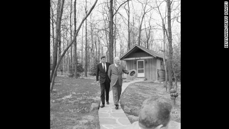 President John F. Kennedy walks the ground, getting a tour from Dwight D. Eisenhower, as the two discussed Cuba, three months after Kennedy won the election.