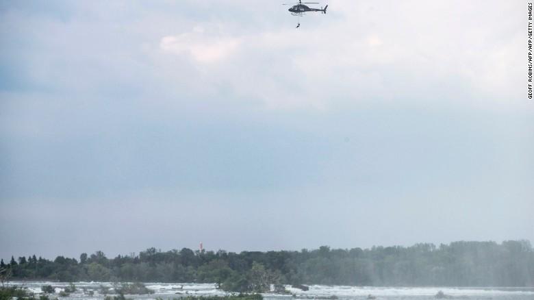Aerialist Erendira Wallenda hangs by her teeth 300 feet above Niagara Falls, New York.