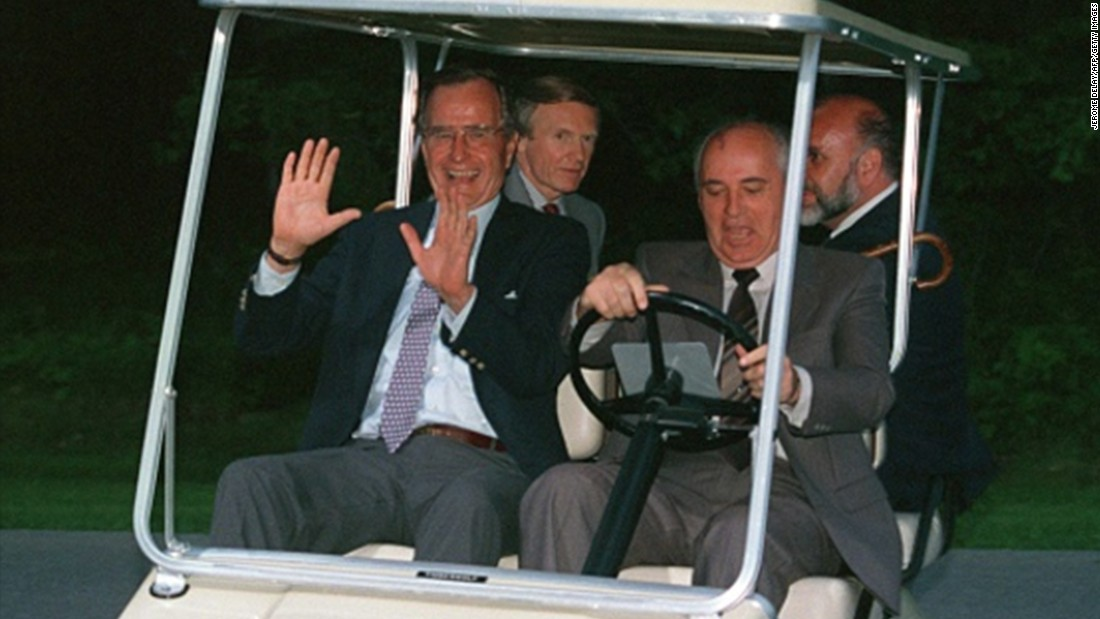 President George H.W. Bush lets Russian President Mikhail Gorbachev take the wheel of the golf cart in June 1990.