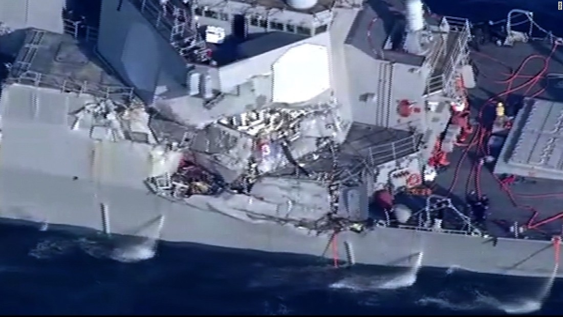 The US Navy destroyer's captain is injured after it collides with merchant ship off the coast of Japan