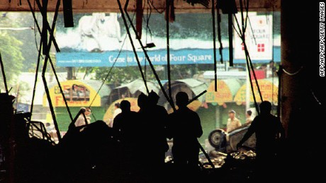 Officials inspect bomb damage in the basement of the Air India building on March 13, 1993. It was one of a series of  bombings that rocked the western port city of Mumbai.