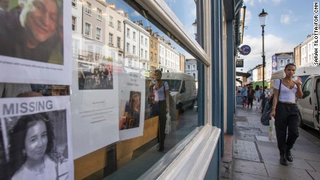 Missing posters are taped inside the window of a local business on Portobello Road, a popular market street in west London.