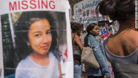 A poster for a missing girl is taped to a pole outside Latymer Christian Centre, one of several community hubs established for people affected by the fire.