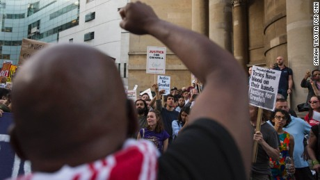 "A protester leads a chant, ""Justice for Grenfell!"" outside the BBC headquarters in central London."