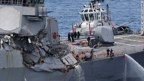 This picture shows damages on the guided missile destroyer USS Fitzgerald off the Shimoda coast after it collided with a Philippine-flagged container ship on June 17, 2017. The US Navy destroyer collided with ACX Crystal cargo ship off the coast of Japan, leaving seven crew members from the American vessel unaccounted for, the Japanese Coast Guard said. / AFP PHOTO / JIJI PRESS / STR / Japan OUT        (Photo credit should read STR/AFP/Getty Images)