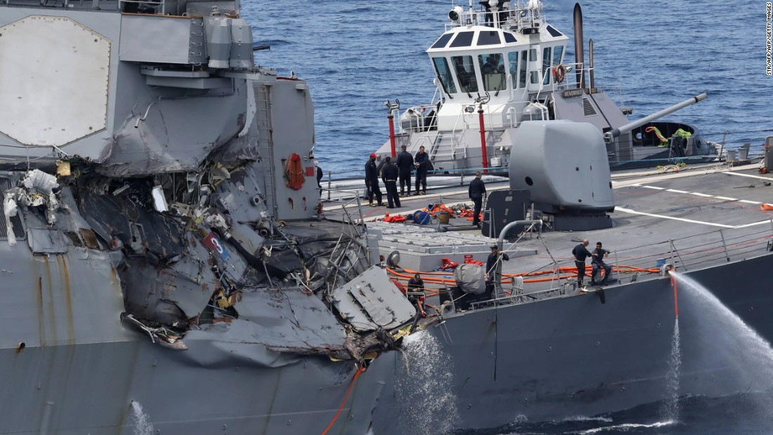 Sailors' bodies were found in flooded compartments more than a day after collision with a merchant ship