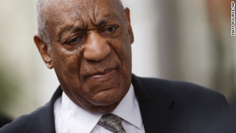 Bill Cosby leaves court Saturday after a mistrial was declared.