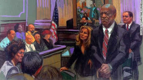 In an artist's sketch, Bill Cosby stands before the court.