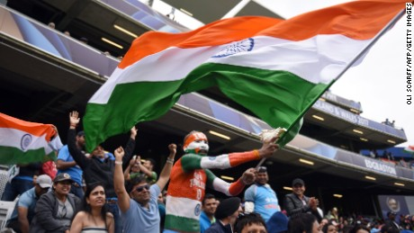 Indian cricket fans cheer and wave national flags during the ICC Champions trophy match on June 4.