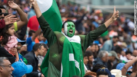 Pakistan fans cheer and wave national flags during the ICC Champions trophy match on June 4.
