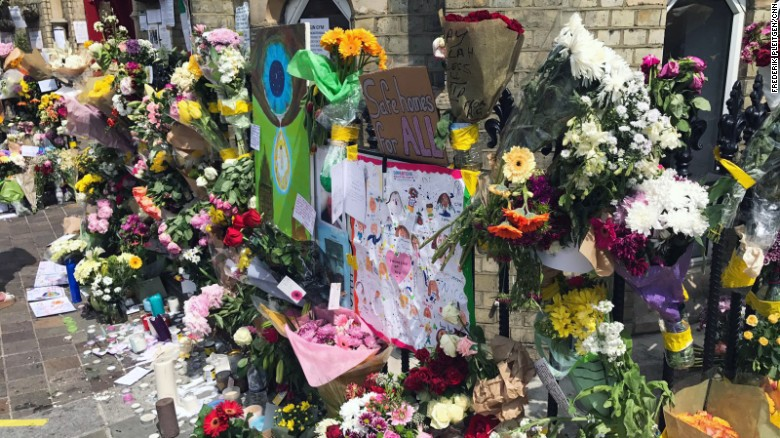 Flowers are placed outside the Notting Hill Methodist Church in west London on Sunday 18 June as a memorial to those who died in Grenfelll Tower fire.
