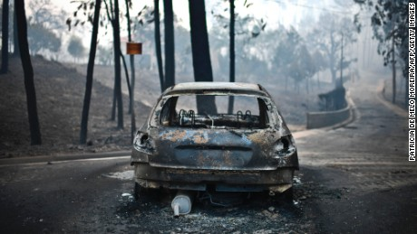 A burned-out car on the road after a wildfire in Pedrogao, central Portugal, on June 18.