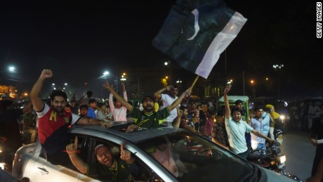 Pakistan fans in Lahore celebrate victory over India in the Champions Trophy final.