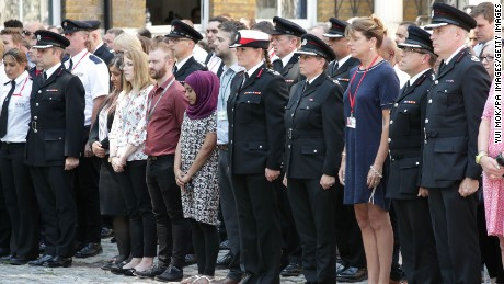 London Fire Brigade Commissioner Dany Cotton (centre) joins firefighters and LFB staff at Winchester House, in central London, to observe a minute's silence in memory of those people who died in last week's fire at Grenfell Tower. (Photo by Yui Mok/PA Images via Getty Images)