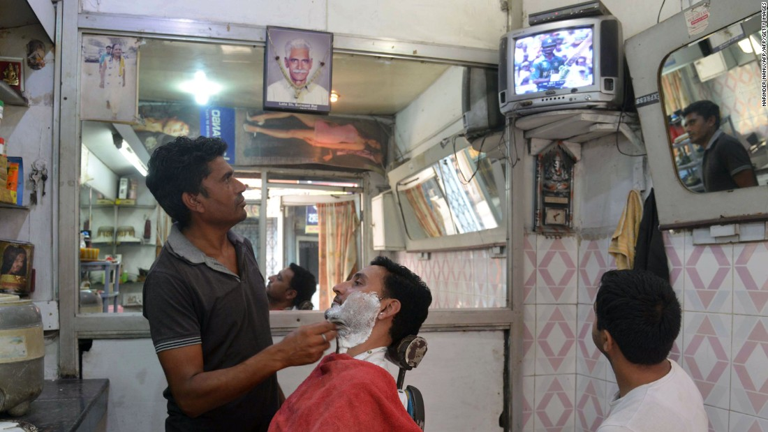 Fans watched on around the world. At a barbershop in Amrista, India fans watched the much-anticipated final in London between two great cricketing nations.