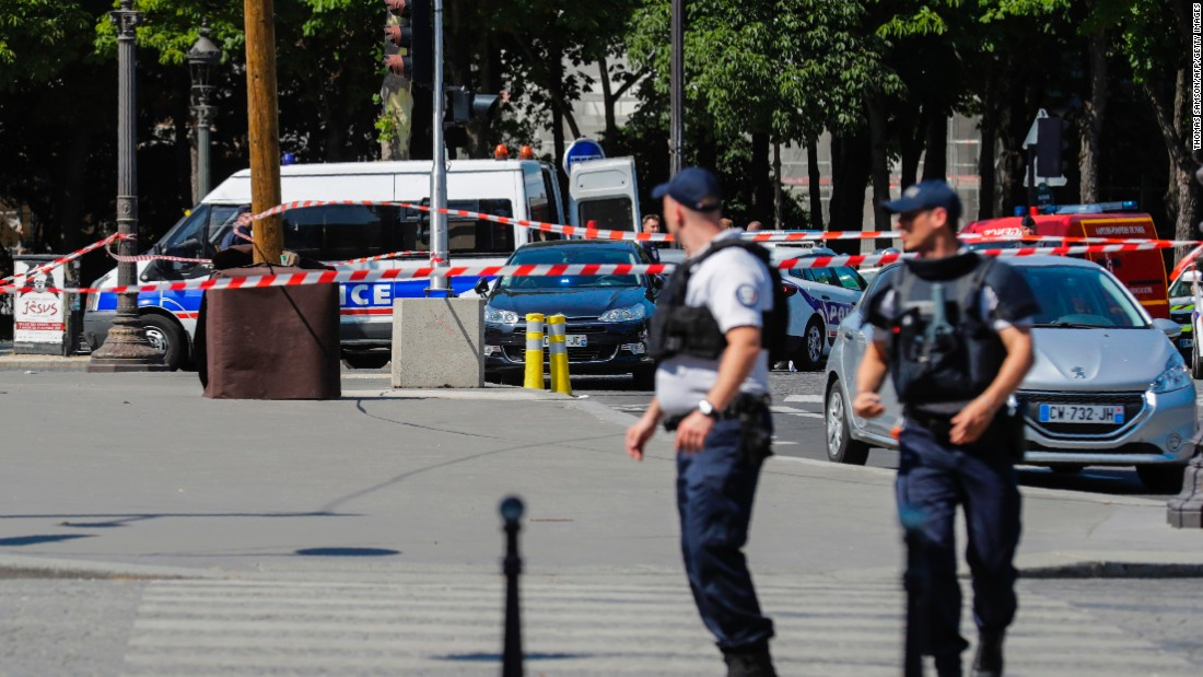 Police officers walk near a sealed-off area on the Champs-Elysees. The incident took place at 3:40 p.m. local time (9:40 a.m. ET).