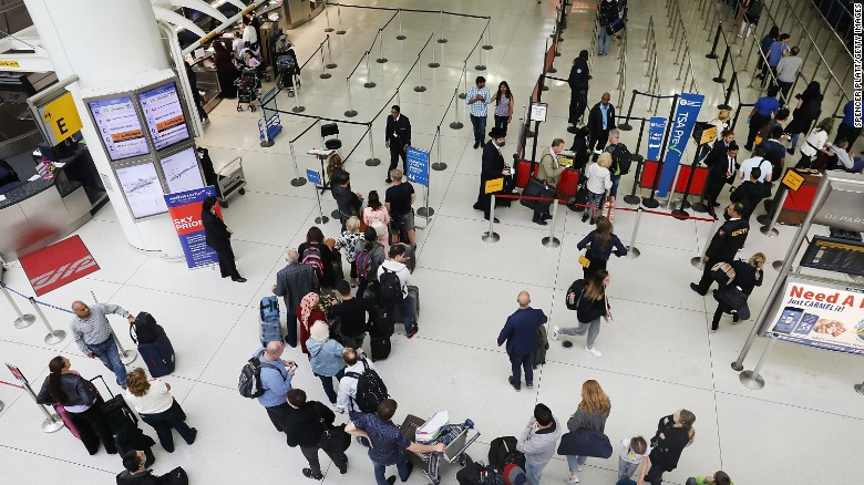 People wait in line at John F. Kennedy International Airport (JFK) in New York City.