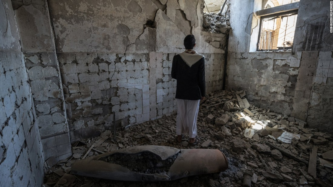 A man stands next to a missile casing in a former government building in Saada City, which was attacked in April 2015. Since the conflict escalated, two years ago, much of the city's infrastructure has been destroyed.