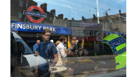 A policeman gives directions to people outside Finsbury Park station. Many on Monday morning were trying to navigate cordons blocking streets around the mosque.