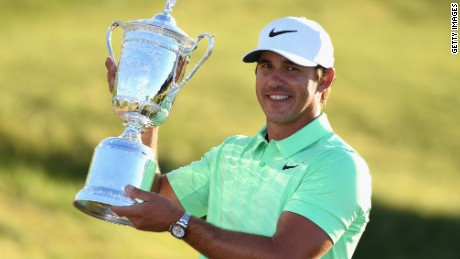 HARTFORD, WI - JUNE 18:  Brooks Koepka of the USA celebrates with the champions trophy after the final round of the 2017 U.S. Open at Erin Hills golf club in Hartford, Wisconsin on June 18, 2017 in Hartford, Wisconsin.  (Photo by Ross Kinnaird/Getty Images)