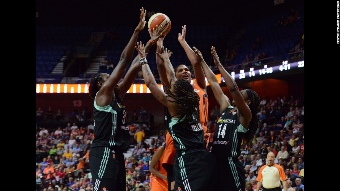 Connecticut's Alyssa Thomas is defended by three New York players during a WNBA game in Uncasville, Connecticut, on Wednesday, June 14. Thomas scored 18 points as Connecticut won the game 96-76.