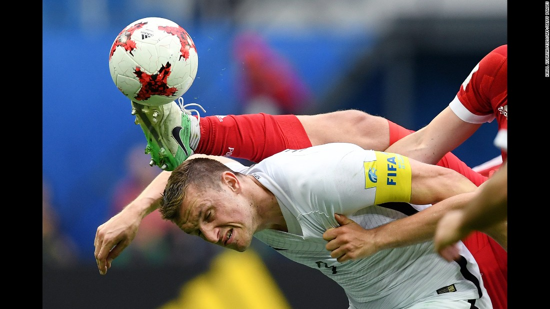 The boot of Russia's Georgi Dzhikiya comes close to New Zealand's Chris Wood during a Confederations Cup match on Saturday, June 17.