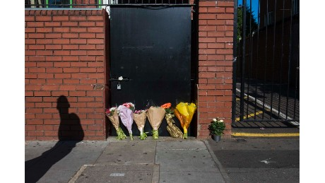 Flowers are left outside the back entrance to Finsbury Park Mosque in tribute to victims of the van attack.
