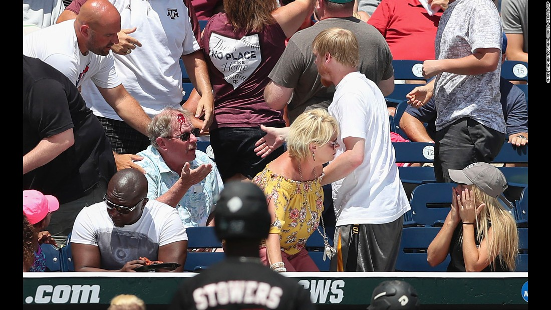 Blood pours from the head of spectator Burke Perry after he was accidentally hit by a baseball bat during a College World Series game Sunday, June 18, in Omaha, Nebraska. The bat had slipped out of the hands of Louisville's Josh Stowers. Burke received first aid and returned to his seat a short time later, according to the Associated Press.