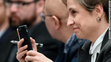 "Mexican journalist Carmen Aristegui holds her mobile phone during a journalists' press conference in Mexico City on June 19, 2017, on an article published by the New York Times: ""Using Texts as Lures, Government Spyware Targets Mexican Journalists and Their Families"". / AFP PHOTO / ALFREDO ESTRELLA        (Photo credit should read ALFREDO ESTRELLA/AFP/Getty Images)"